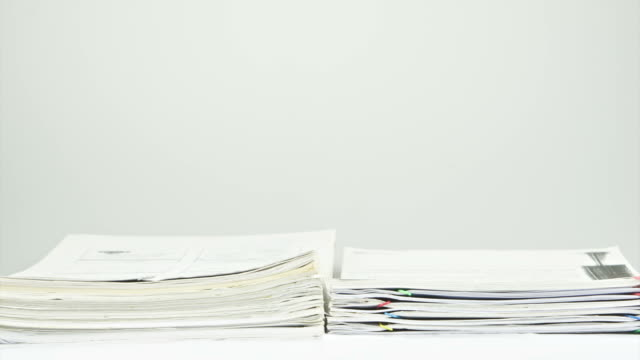 Stack old overload paperwork report on table time lapse video