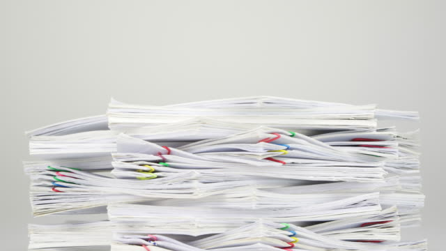 Stack overload document on white table time lapse video
