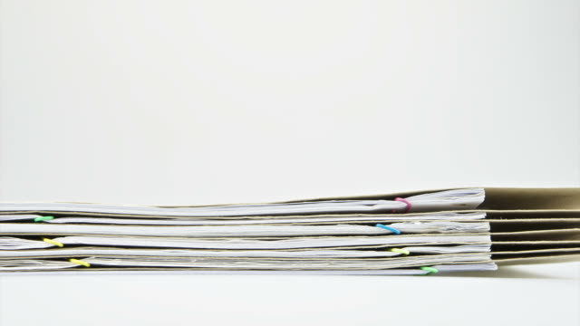 Stack paper report and envelope on table time lapse video