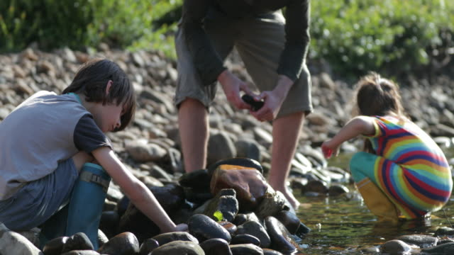 Stacking Rocks in the River