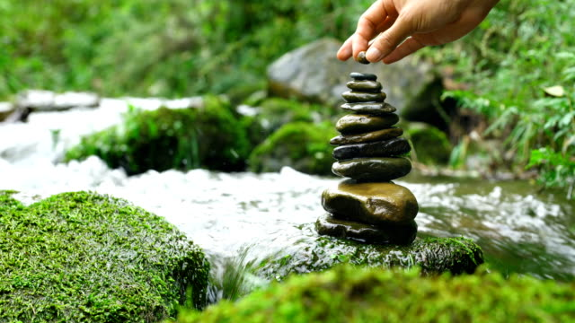Stacking zen stones in nature