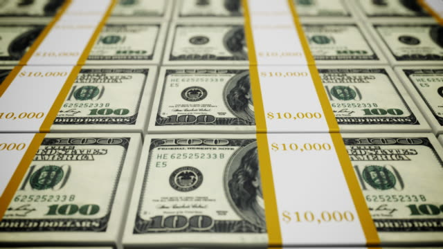 Stacks of 100 dollar bills - loopable, HD video