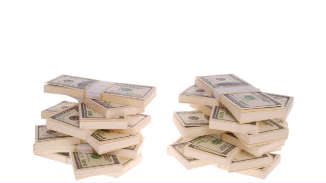 Stacks of 100 dollar bills on white background.