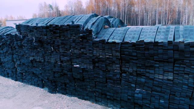 Stacks of geogrid on pallets on the stock of the plant video