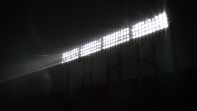 Stadium Floodlights, with sound. White. Lights flashing. 5 shots in 1 video.  Five sizes of Stadium floodlights shining brightly and turning on and off. Based on true lights shot with Cannon 7D. Loopable. Full HD. electric light stock videos & royalty-free footage