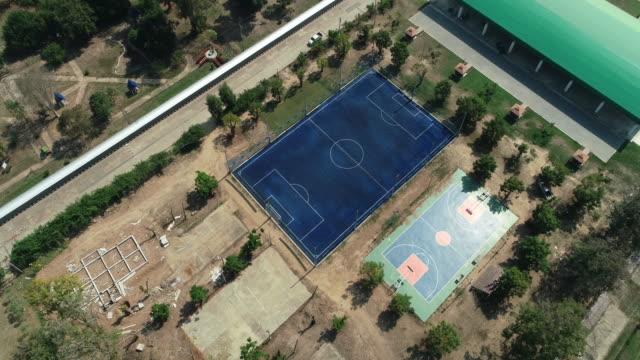 vídeos de stock e filmes b-roll de stadium foot ball, drone shot on daylight. - campeão soccer football azul