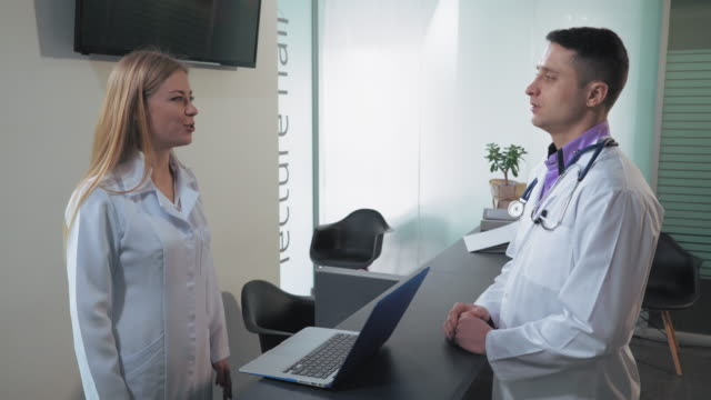 Staff in hospital have conversation video
