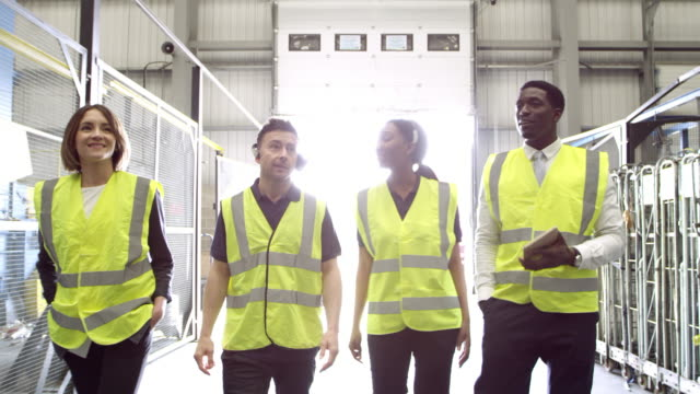 Staff inspecting an industrial building, shot on R3D video
