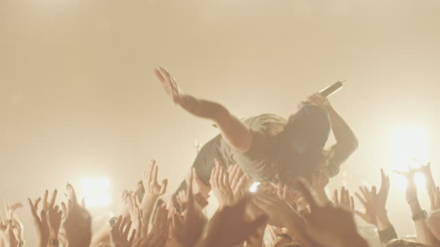 Stage diving Singer of a rock band stage diving on concert.   rock music stock videos & royalty-free footage