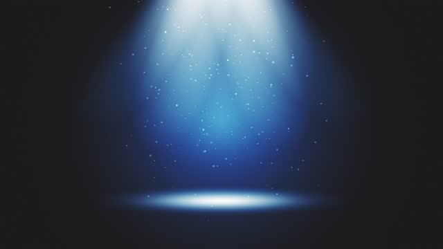 Stage light shining at blue studio. Big spotlight illuminate the scene from sky. Rays of lights on stage with glowing sparkles. All the lights gather in one point. The concepts of performance arts, party, lighting, event, celebration, UFO, teleportation