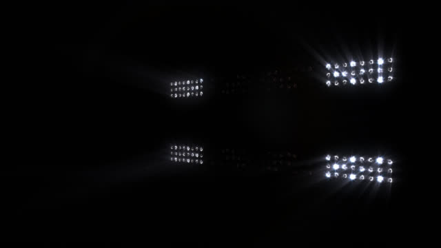 Stage lights flashing, with sound. White. Bright concert lights. Loopable. video