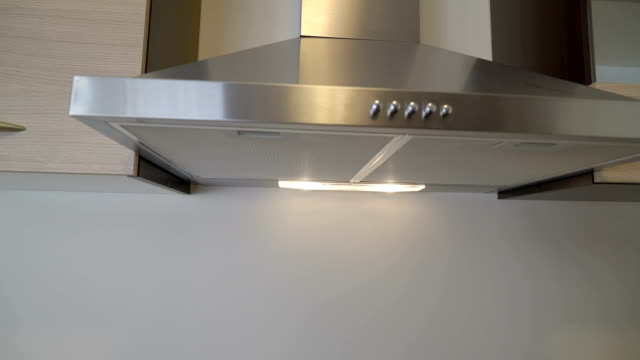 A stainless hood on the kitchen house video