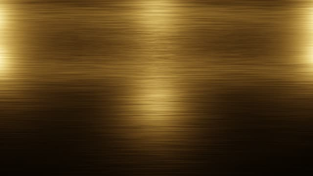 stainless steel golden metal background texture. incident light on the texture of the gold metal. lightening and darkening of metal. - acciaio inossidabile video stock e b–roll