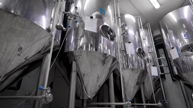 stainless steel tanks for brewing beer in workshop of modern brewery, automatized process stainless steel tanks for brewing beer in workshop of modern brewery, automatized process, moving shot stainless steel stock videos & royalty-free footage