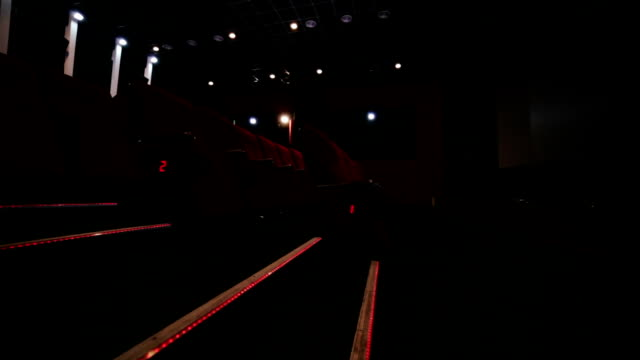 Staircase and aisle in red empty cinema hall video