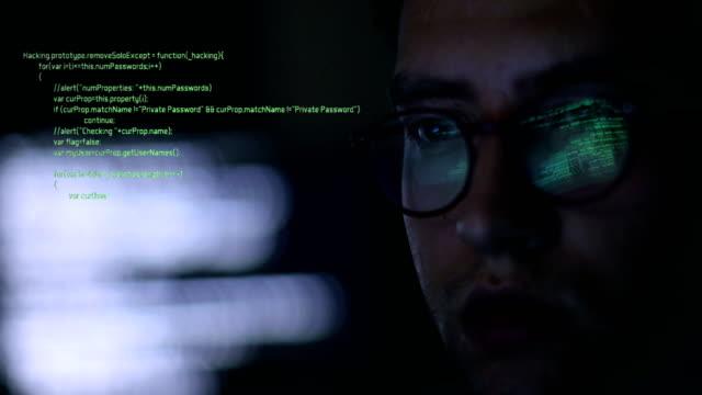 stalker, it man, businessman or hacker man working on computer - kradzież tożsamości filmów i materiałów b-roll