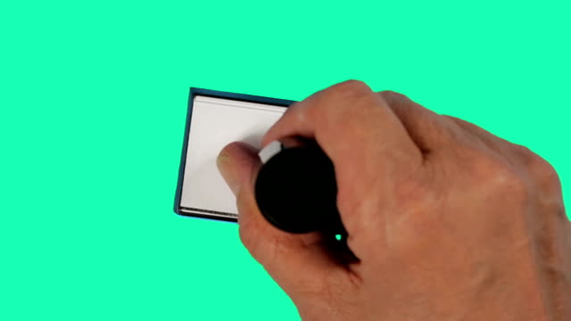 "Stamp like    ID CO Green screen overhead clip of a man's hand using a rubber stamping tool to make a ""thumbs up"" (like) symbol on anything you choose. This could be used to accredit / approve almost any service or product & apply motion to a still image. stamp stock videos & royalty-free footage"