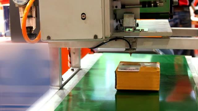 Stamp machine in warehouse video