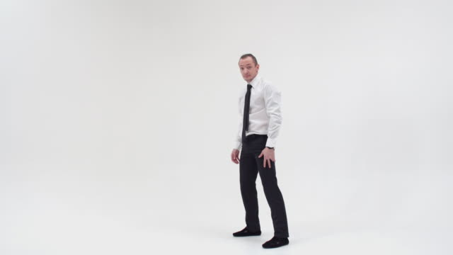 Stand on one hand of a guy in office clothes. A businessman stands on his hand on a white background