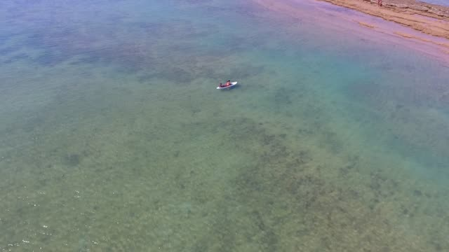 Stand up paddle. People on the surf board. Kayak. video