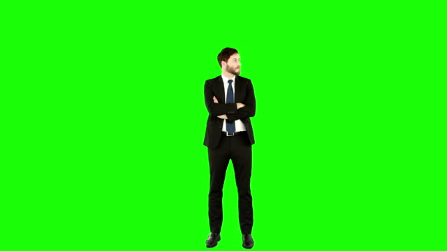 Standing businessman with arms crossed Standing businessman with arms crossed on green screen standing stock videos & royalty-free footage