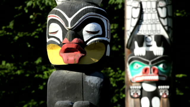 Stanley Park Totem Poles Vancouver, BC, Canada, downtown Stanley Park's collection of Native totem poles, dolly shot, rack focus vancouver canada stock videos & royalty-free footage