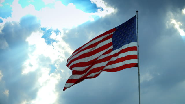 Stars and Stripes Flying in Wind from Back video