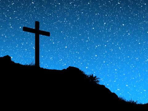 stars hinter cross - religiöses symbol stock-videos und b-roll-filmmaterial