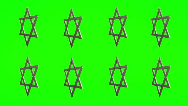 vídeos y material grabado en eventos de stock de estrellas de david sobre fondo verde - jánuca