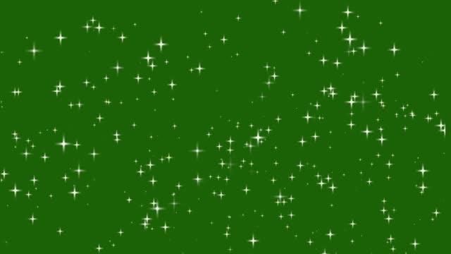 vídeos de stock e filmes b-roll de stars shine effect background on green screen animation. christmas decoration. - glow