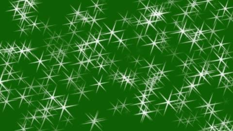 vídeos y material grabado en eventos de stock de las estrellas brillan en la animación de fondo de la pantalla verde. estrellas de navidad. - luz brillante
