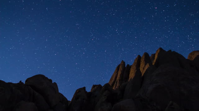 stars wheeling over desert rocks - time lapse - rock formations stock videos & royalty-free footage