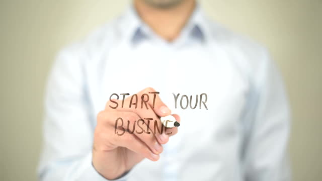 Start Your Business,  Man writing on transparent screen
