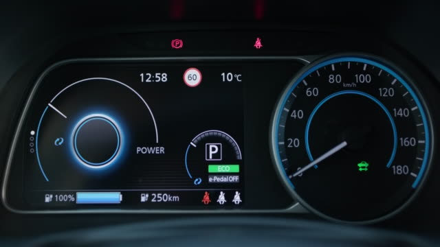 vídeos de stock e filmes b-roll de starting electric car dashboard. track in to the button. finger press the button to start the car engine. car dashboard during start engine on the darkness - led painel