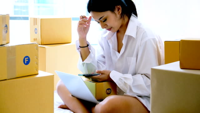 startup small business owner working at home.women worry about online sales.online selling, e-commerce, shipping concept - fare la lotta video stock e b–roll