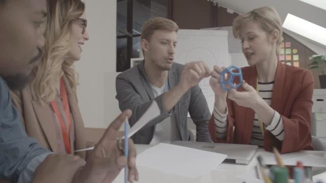 4K: Start-up Team Brainstorming in 3D Printing office. video