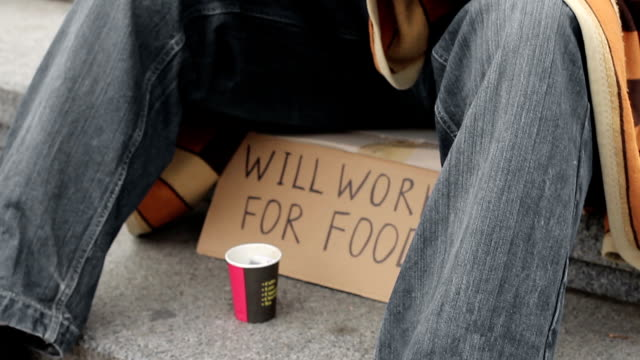 Starving homeless man eating canned food and asking for help, destitution video