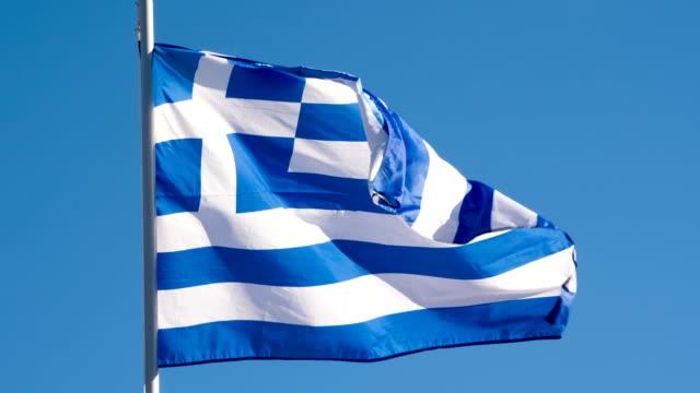 vídeos de stock, filmes e b-roll de bandeira do estado de greece - atenas grécia