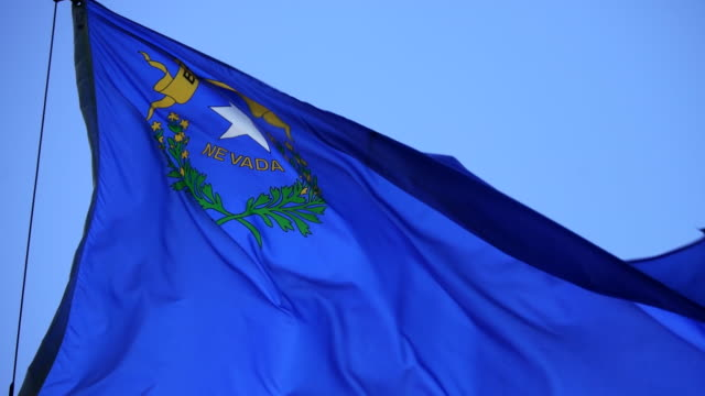 state flag of nevada waving in the breeze - 4k/uhd - nevada video stock e b–roll