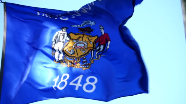 State Flag of Wisconsin waving in the breeze - 4k/UHD video