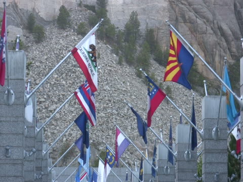 NTSC: State Flags at Mt. Rushmore State flags blowing in the breeze at Mt. Rushmore National Monument, South Dakota, USA. mount rushmore stock videos & royalty-free footage