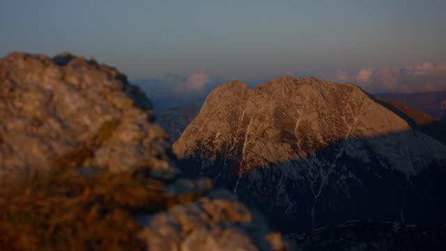 static shot of mountains at sunset - styria filmów i materiałów b-roll