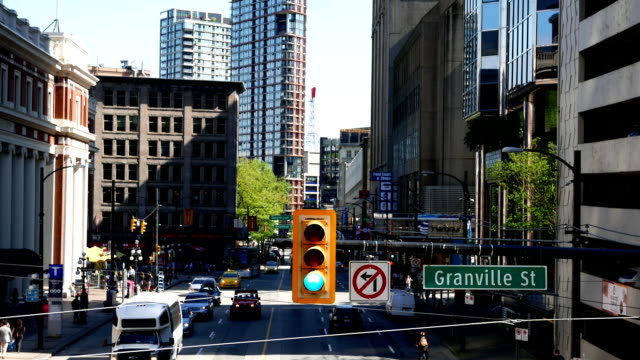 Static shot of traffic lights on granville street in the downtown Vancouver Static shot of traffic lights on granville street in the downtown Vancouver vancouver canada stock videos & royalty-free footage