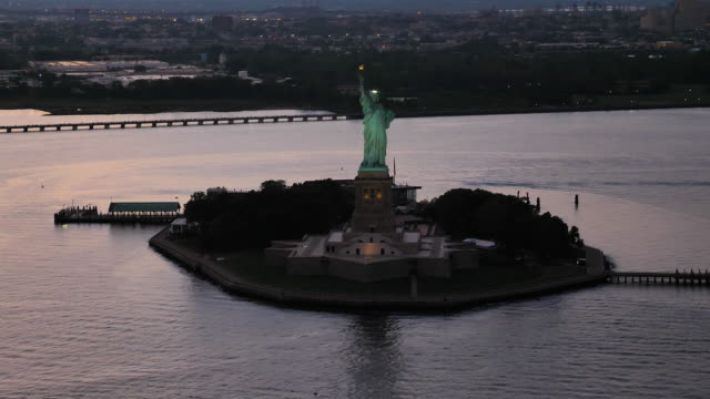 Statue of Liberty aerial view in front New York city