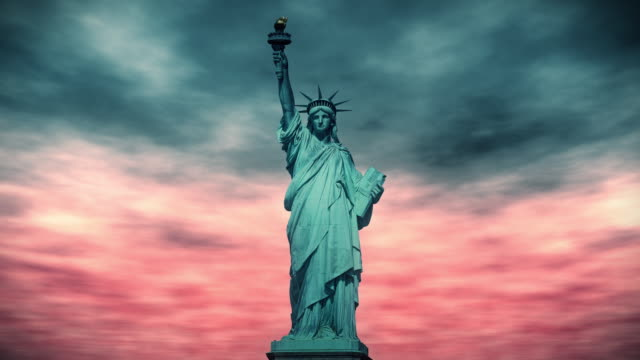 Statue of liberty against a dramatic red sky background