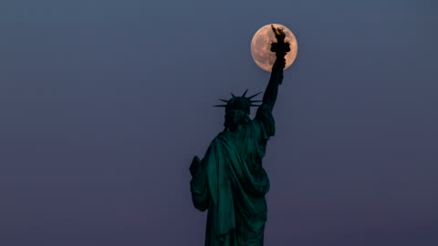 Statue of Liberty and Full Moon - 4K Time lapse Statue of Liberty and Full Moon - Unique Time lapse in 4K wide resolution famous place stock videos & royalty-free footage