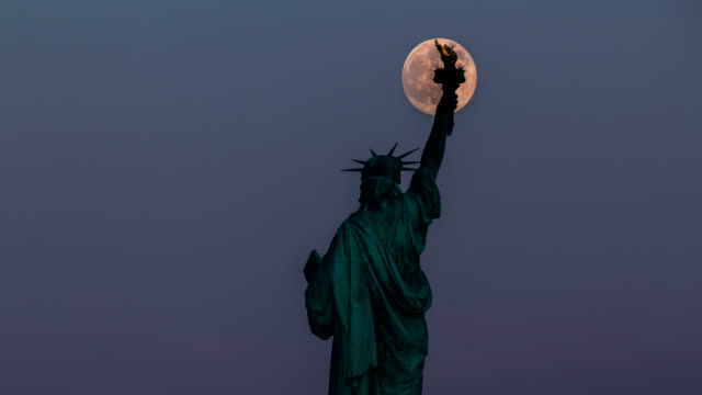 Statue of Liberty and Full Moon - 4K Time lapse video