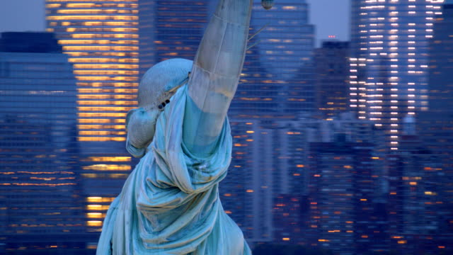 Statue of Liberty at dusk, closeup aerial shot video