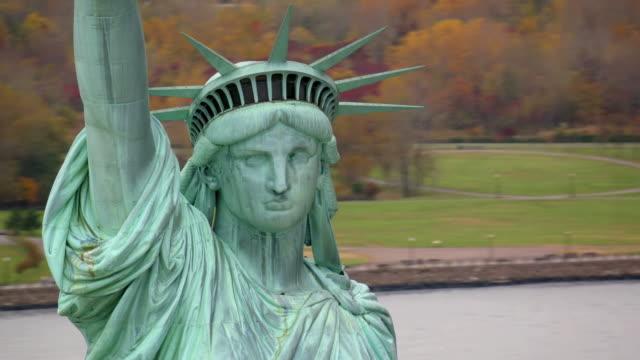Statue of Liberty closeup, aerial shot video