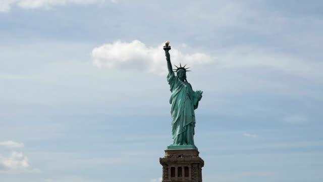statue of liberty in cloud sky